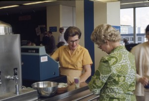 Cashier_in_Seattle_City_Light_cafeteria,_1970_(22608448685)